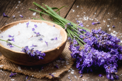 Sea salt and fresh lavender on an old wooden table